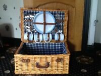 Picnic basket. Includes four plastic place settings in blue and white.