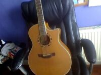 Crafter left-handed electro-acoustic guitar
