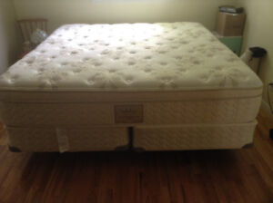 King Mattress and box spring with bed frame.
