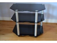 Elegant black glass TV stand with three shelves to accommodate other devises