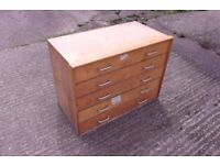 Wooden storage unit with drawers