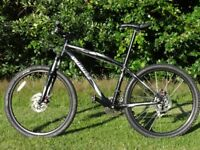 "Specialized Hardrock Sport. Excellent Condition. 24 Sp. Disc Brakes. 26"" Wheels."