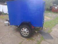 A car trailer 5feet x4feet x 3feet highe leaf springs lights