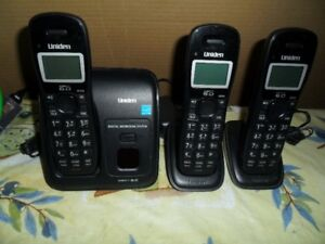 3 Uniden cordless phones with answering machine