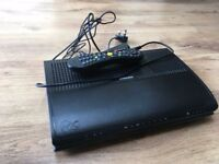 Virgin Media box with power cable and remote