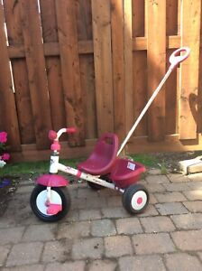 Pink Kettler tricycle with removable handle