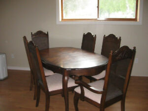Beautiful wooden dining room set with matching hutch