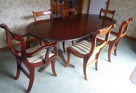 Wood Veneered Twin Pedestal Dining Table and 6 chairs in deep mahogany colour