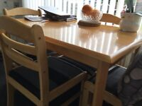 Light wood table with four chairs, cushioned seats, in excellent condition