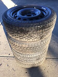 4- 205/55 R16 continental winter tires on rims