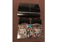 PlayStation 3 (PS3) + 2 Controllers + 3 Games including Grand Theft Auto V
