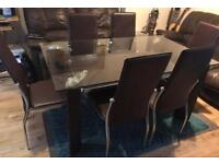Double tier glass dining table and 6 leather chairs for sale great condition delivery available