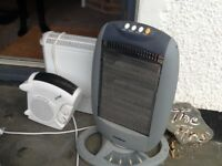Three fully working electric heaters with various settings and sizes.