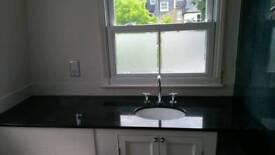 Black granite bathroom worktop and basin