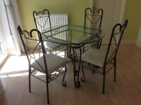 Crircular Glass topped table with four chairs