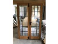 Pair of glass panelled leaded exterior oak doors