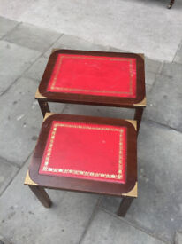 Nest of 2 Tables , leather topped with brass corners . Good quality.