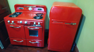Red retro style fridge and gas stove