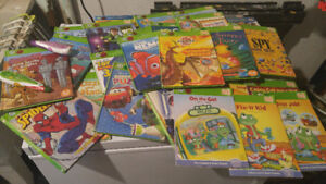 2 leapfrog tag reader pens and 28 tag reader books