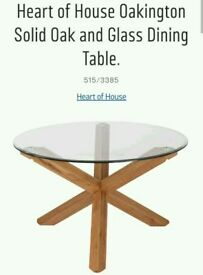 Glass table with 4 brown suede dining chairs