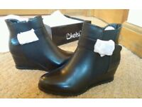 Faux leather black wedge heel boots, brand new, size 4