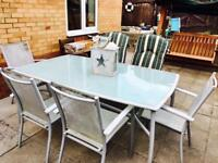 Patio table with 6 chairs including covers