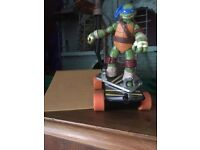 TMNT SEWER SKATEBOARD AND FIGURE