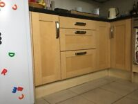 Range of kitchen base and wall units in light wood. Plus AEG built-in oven and gas hob.