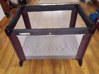 A baby travel cot for sale