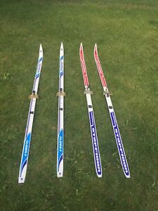 2 PAIRS OF CROSS COUNTRY SKIS