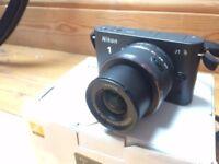 Nikon 1 J1 digital camera + Nikon 10-30mm lens + LowePro case