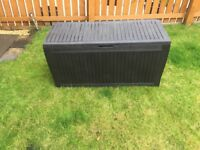 Keter Wood Effect patio storage box with 270l capacity.