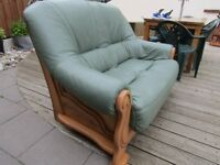 green real leather 2 seater sofa