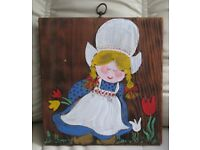 "OIL PAINTING OF ' DUTCH GIRL' in traditional costume with tulips, 12"" x 11"" painted on block of wood"