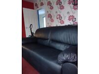 Black leather faux leather sofas 2 +3 seating