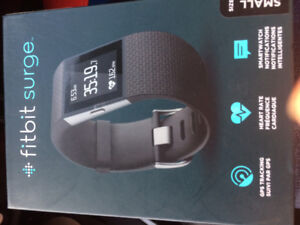 UNOPENED FITBIT BLAZE AND FITBIT SURGE
