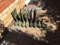Various green garden boots