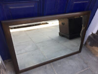 ERCOL Mirror , in dark elm , good condition . Can be hung both ways .. Size L 34in H 24in.