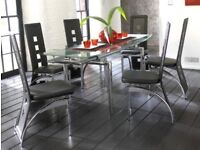 Harvey's dining table and 6 black chairs