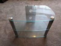 Clear glass and silver TV stand.
