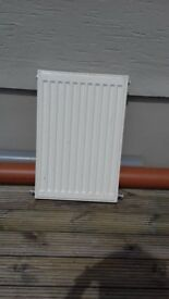 6 White Radiators, with 4 thermostats and return shutoff valves. Good Condition.