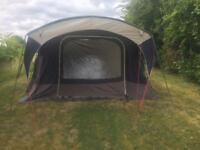 8 man tent, 4 bedrooms, carpeted seating area and seated porch