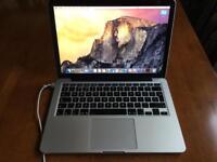 2015 MacBook Pro 13-inch Retina display. 8GB RAM 2.7GHz 128GB Flash Storage.