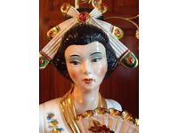 6ft Asian ceramic figure with overhead electric lamp.