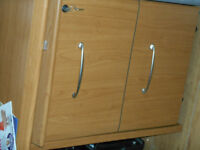 A 2 drawer lockable filing cabinet and desk to match