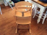 Wooden high chair that pulls up to the table