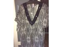 Two jewelled beach cover ups size 20