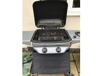 Barbecue grill with lava rocks, side burner, cover and gas cylinder