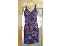 4 dresses,1 top. Sizes 8-10. £40. Worn once. From Guess,Lipsy,Topshop,Boohoo&DV8. Great condition.