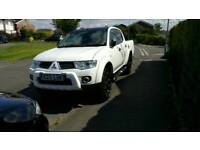 Mitsubishi L200 Roll and lock and roll bars